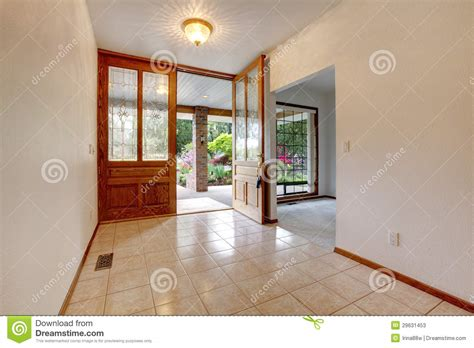 empty front entrance with open door home interior stock