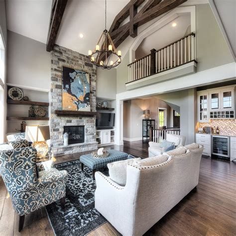 living room stone fireplace chandelier  story great