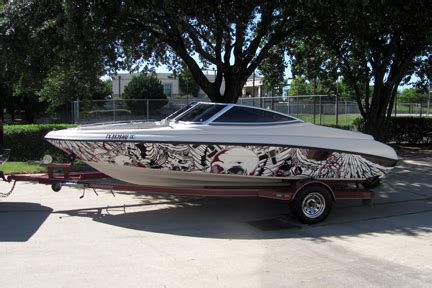 boat show graphics design boat wrap wood boat deck caulking cigar speed