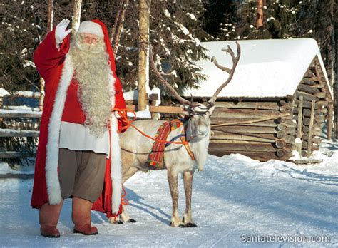 photo santa claus and his favorite reindeer in lapland in finland