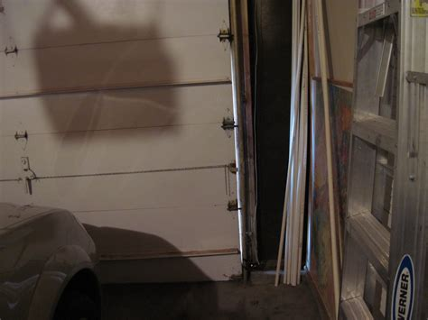 Garage Door Gap Side Diy 3 Garage Door Weatherstripping Woman With A Hammer