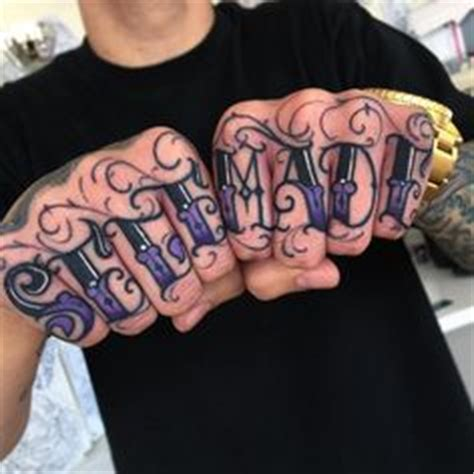 jesus knuckle tattoo top 50 best hand tattoos for men fist designs and ideas