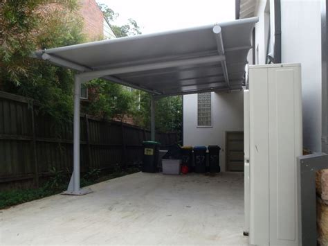 Single Garage With Awning by Cantilevered Carport Awning With Poles Only One Side