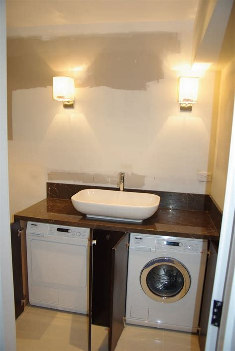 how to hide washer and dryer in bathroom 1000 ideas about washing machines on pinterest wash
