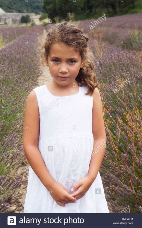 8 in years beautiful 8 years standing in a lavender field with the stock photo royalty