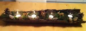 Diy Winter Wonderland Decorations - adventskranz in einer baumrinde mit moos bedeckt ikea kerzenhalter schleich tieren hirsch