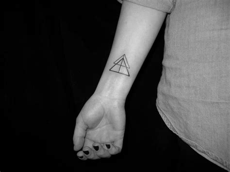 hipster wrist tattoos overlapping triangle and geometric wrist design