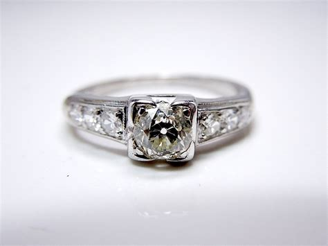 mine cut engagement ring by ajmartinjewelry on