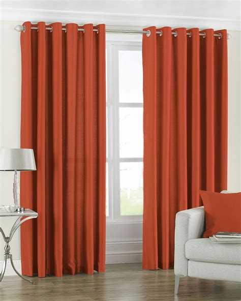 Paoletti fiji faux silk pair of eyelet curtains in burnt orange next day select day delivery