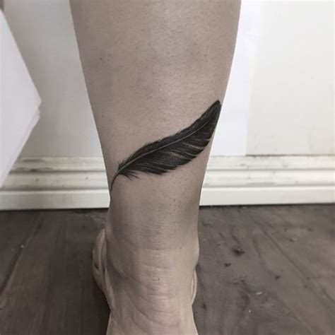 feather knee tattoo 53 crow feathers tattoos designs and meanings 2018