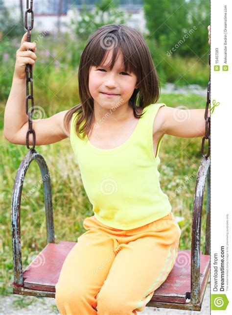 swing age the child on a swing stock photos image 15407583