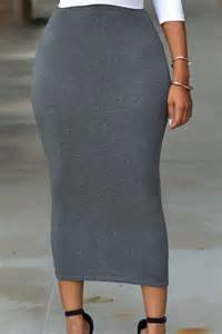 Women in solid grey high waisted bodycon maxi skirt