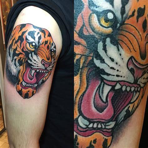tattoo old school tigre significato stefano bonura tattoo tigre spalla ligera ink studio