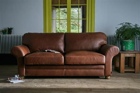 curved sofa leather the curved arm leather sofa by indigo furniture