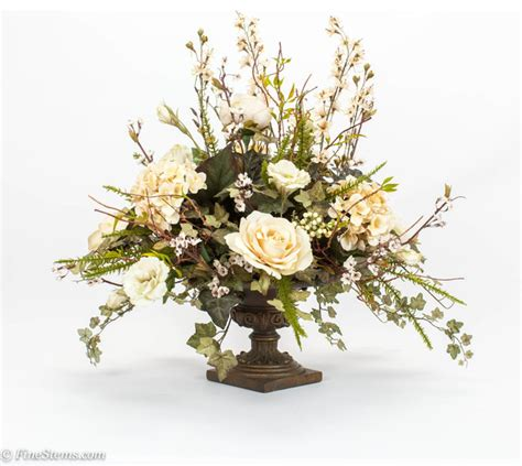 artificial floral arrangements cream centerpiece silk floral arrangement placed in a bronze urn traditional artificial