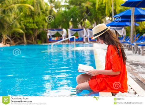 Best Books For Pool Side Reading by Reading Book Relaxing In Swimming Pool Stock
