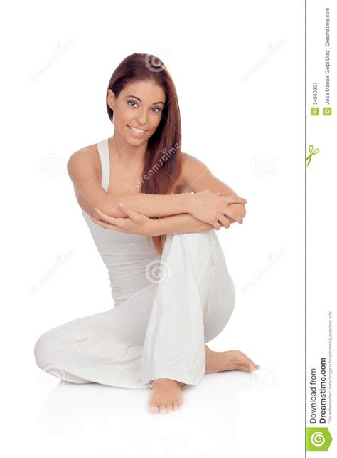 how to sit comfortably on the floor happy young woman with white comfortable clothing sitting