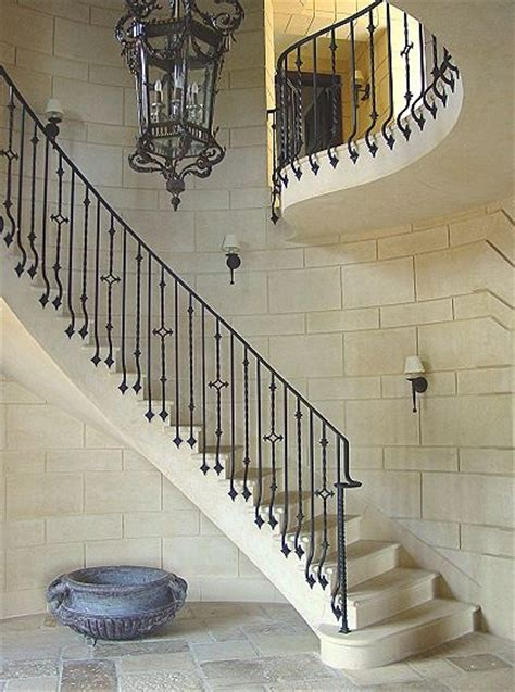 banister in spanish wrought iron railing at stone staircase and cut stone