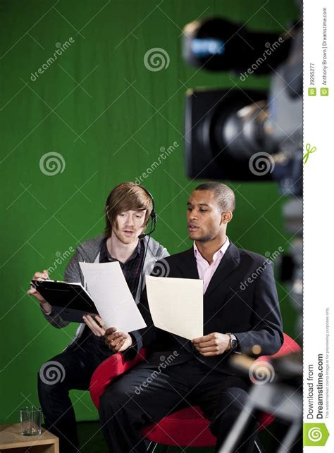 Studio Floor Manager by Floor Manager Briefing Presenter In Tv Studio Royalty Free