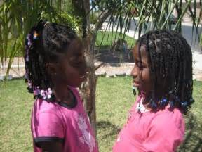 Braids with beads hairstyle african american little girls