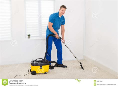 Vacuum Cleaner Happy King janitor cleaning carpet stock photo image 58874241