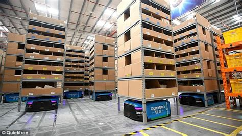alibaba robot china s largest smart warehouse is manned by 60 robots