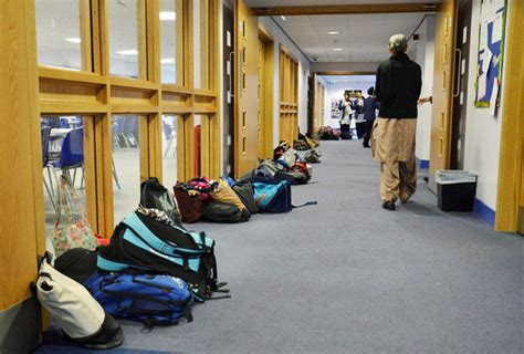 Bags On The Floor by Pigeon Shelves Installed For The Guru Nanakh Academy