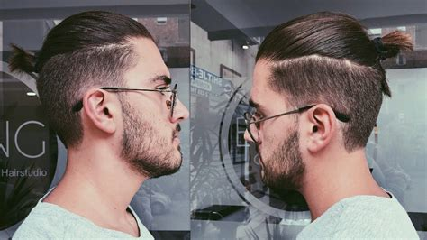 clip on top knot for men disconnected undercut haircut with a top knot man bun