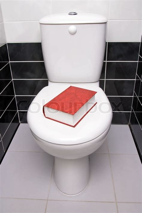 The Water Closet by Book Is On The Water Closet Lid Stock Photo Colourbox