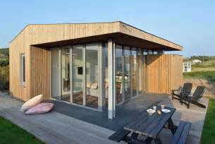 compact homes using corner folding glass doors makes this compact design
