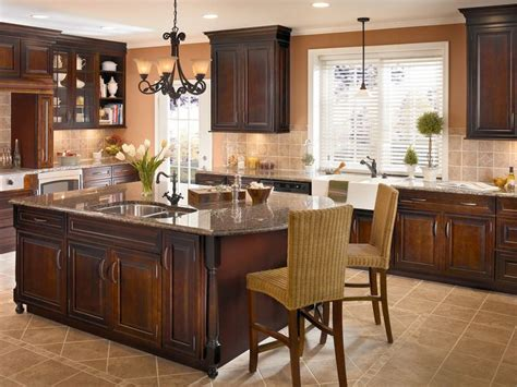 kitchen cabinets kraftmaid crown molding turned legs and mullion glass doors add