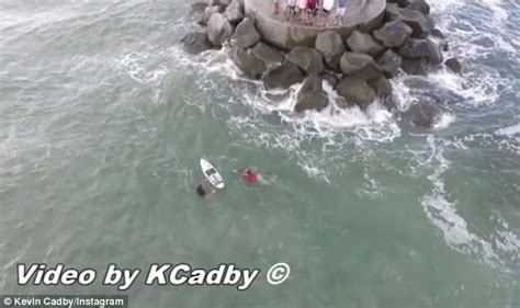 boat sinks in jupiter inlet boat capsizes and captain is rescued by surfer 13