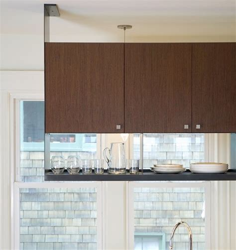 how do you hang kitchen cabinets artistic methods to use hanging storage in your kitchen