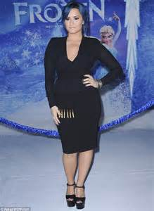 demi lovato song in frozen demi lovato wears a very revealing black ensemble to white
