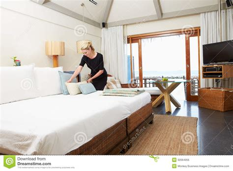 bed making by the staff picture of hotel goldi sands hotel chambermaid making guest bed stock photo image