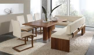 graceful dining room set with bench and white fur rug with sliding