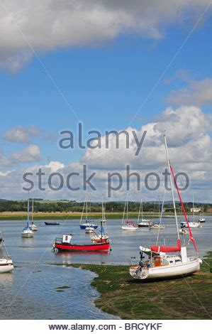boat fishing in chichester harbour boats at dell quay chichester harbour sussex stock photo