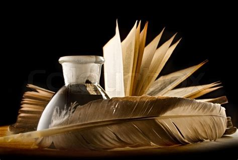 Fn A Quill a feather with the bottle of ink and a book stock photo colourbox