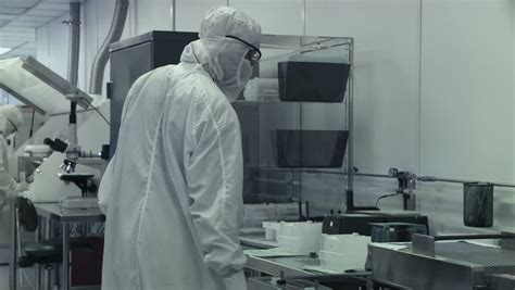 Clean Room Bunny Suit by Big Up Of A Technician Working On Silicon Chip