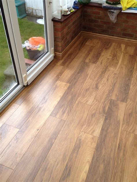 is laminate flooring durable with pets hardwood floor vs laminate which flooring gives the