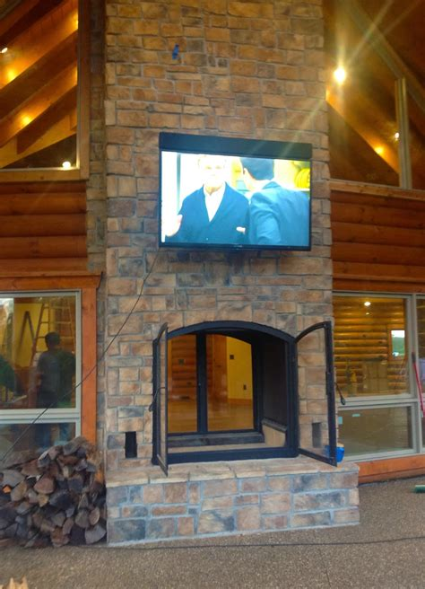 Indoor Outdoor Wood Burning Fireplace acucraft fireplaces custom see through wood burning indoor outdoor fireplace