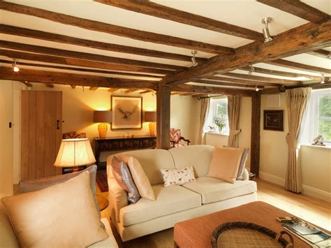 17th Century Thatched Cottage   Country   Living Room   south east   by Icon Interiors Ltd