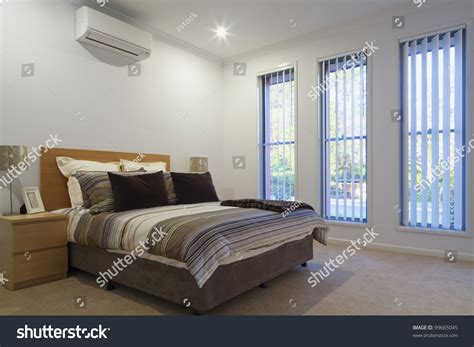 new air conditioned bedroom with bed pillows and covers stock photo 99665045