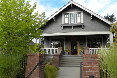 gray paint exterior craftsman with a frame brick bungalow beeyoutifullife