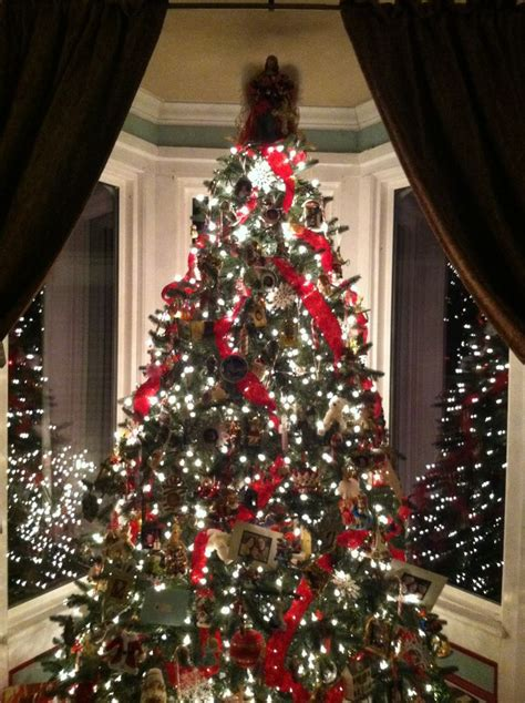 christmas tree w velvet ribbons collected ornaments and
