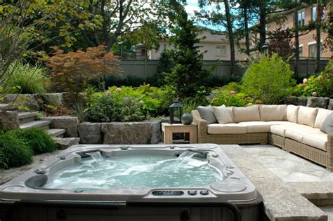 backyard hot tub landscaping ideas with wicker patio sofa