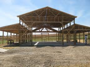 Pole Barn Plans strikking pole building framing with wooden materials as