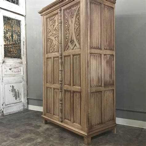 antique stripped carved solid oak armoire at