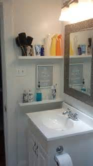 small bathroom storage idea by the sink shelving home