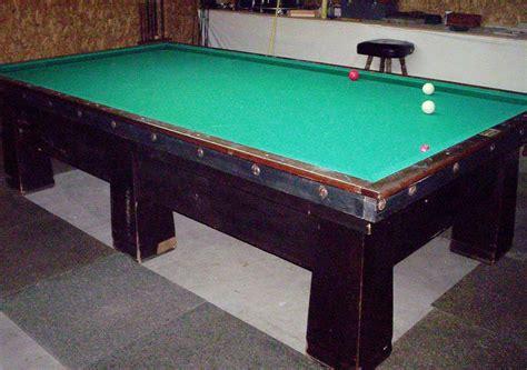 my antique brunswick carom table in my garage